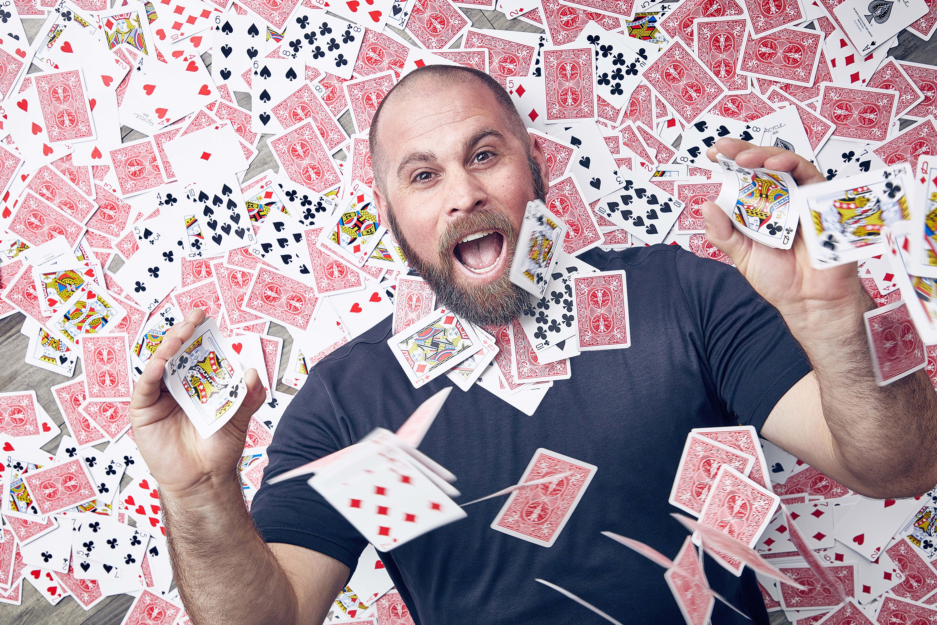 Magician Jon Dorenbos surrounded by playing cards